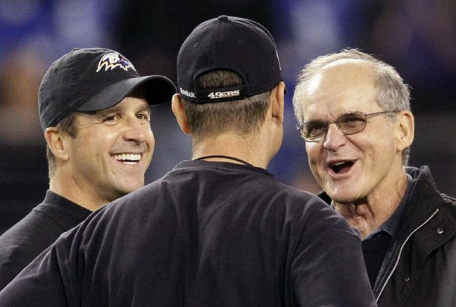 Ravens coach John Harbaugh, left, and his younger brother, Jim, will coach against one another in the Super Bowl. Their father, Jack Harbaugh, right, was a longtime college coach. Photo: Patrick Semansky