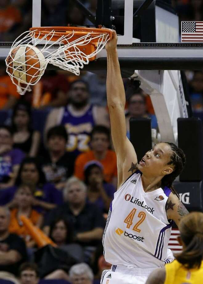 Phoenix Mercury player and former Baylor star Brittney Griner dunks against the Chicago Sky during the second half on May 27 in Phoenix. It's been 15 years since Sylvia Crawley won the ABL slam dunk contest with a blindfolded jam. With so many more women who can dunk, including Griner, it may not be long before it becomes part of WNBA All-Star weekend. Photo: Ross D. Franklin