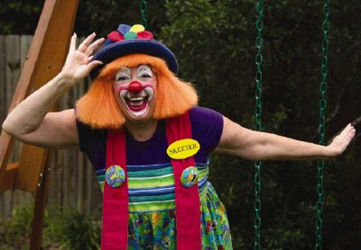 Becky Deltenre, a Conroe resident, dresses as Skeeter the clown for fun and as a second job. She works as the children's director at the Community Christian Church in The Woodlands and has found that dressing as a clown is a good way to connect with children. Go to HCNPics.com to view and purchase this photo and others like it.