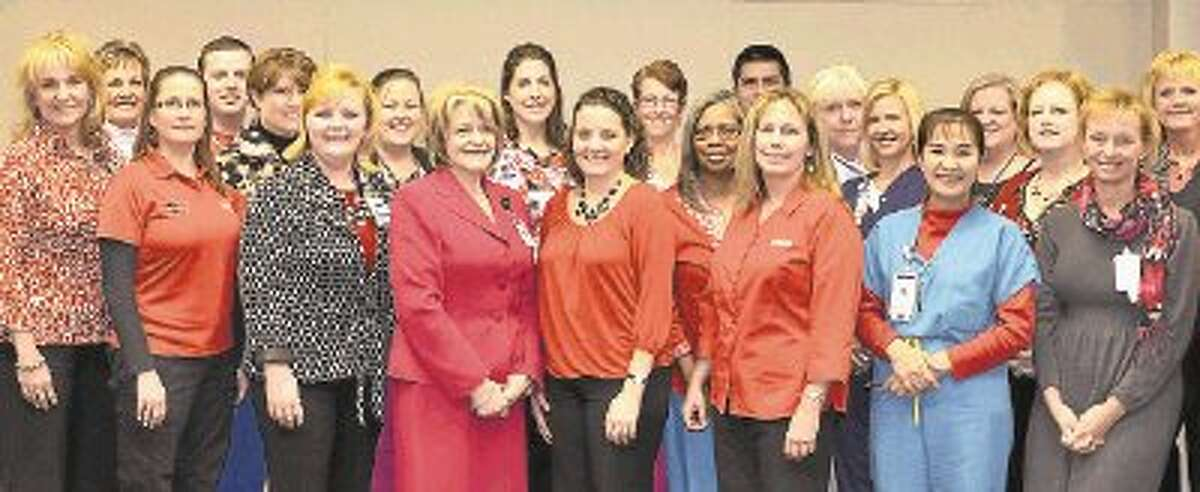 Pictured are members of the nursing leadership team at Memorial Hermann The Woodlands Hospital, led by Chief Nursing Officer Glenda Cox, MSN, MHA, RN (in pink suit).