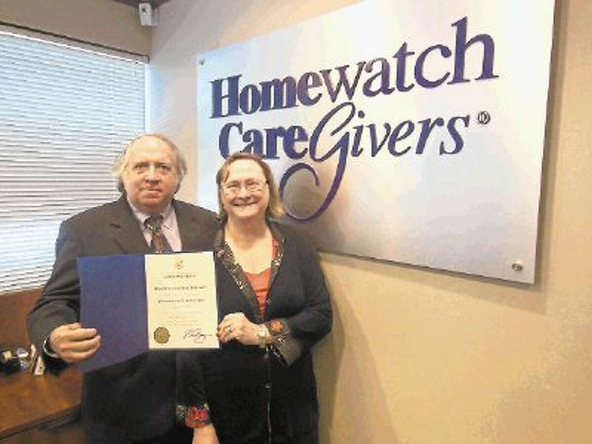 Beverly and Dick Brinson display their commendation for 10 years of service at Homewatch CareGivers from U.S. Rep. Kevin Brady, R-The Woodlands.