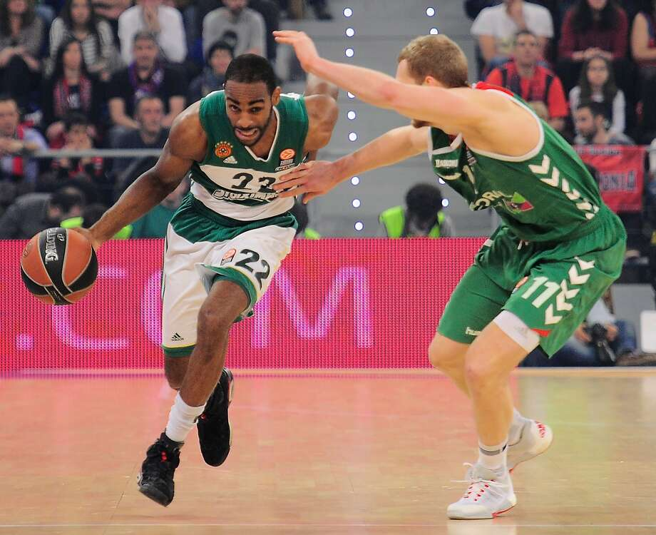 Panathinaikos' US guard Elliot Williams (L) vies with Laboral Kutxa's Slovenian guard Jaka Blazic during the Euroleague group basketball playoff match Laboral Kutxa Vitoria Gasteiz vs Panathinaikos Athens at the Fernando Buesa Arena in Vitoria-Gasteiz on April 15, 2016. / AFP PHOTO / ANDER GILLENEAANDER GILLENEA/AFP/Getty Images Photo: ANDER GILLENEA, AFP/Getty Images