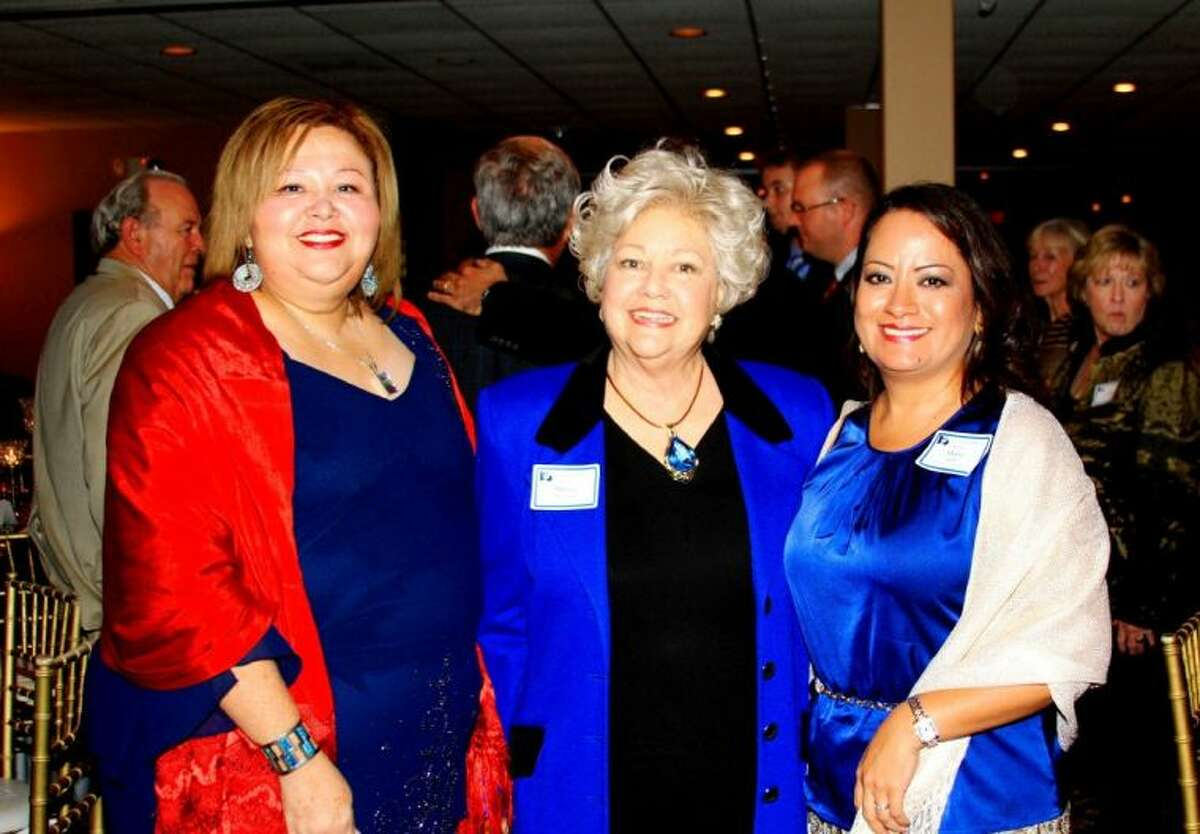 Marlen Tejeda, Marisa Olivares Rummel and Maria Banos Jordon were presented with Proclamations from the Texas State Senate and words of praise from Montgomery County Chairman Dr. Wally Wilkerson last week at a Republican Party Fundraiser at River Plantation Country Club.