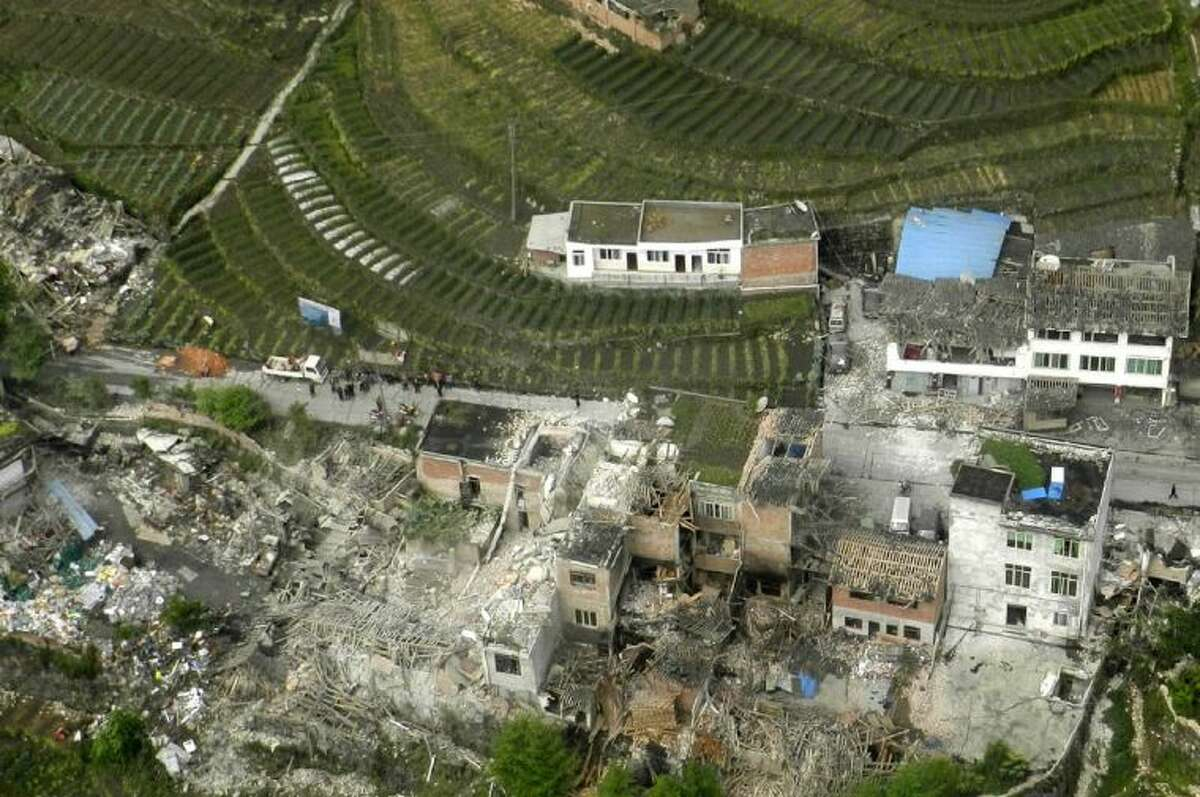 This aerial photo released by China's Xinhua news agency shows destroyed houses after a powerful earthquake hit the Taiping town of Lushan County in Ya'an City, southwest China's Sichuan Province, Saturday.