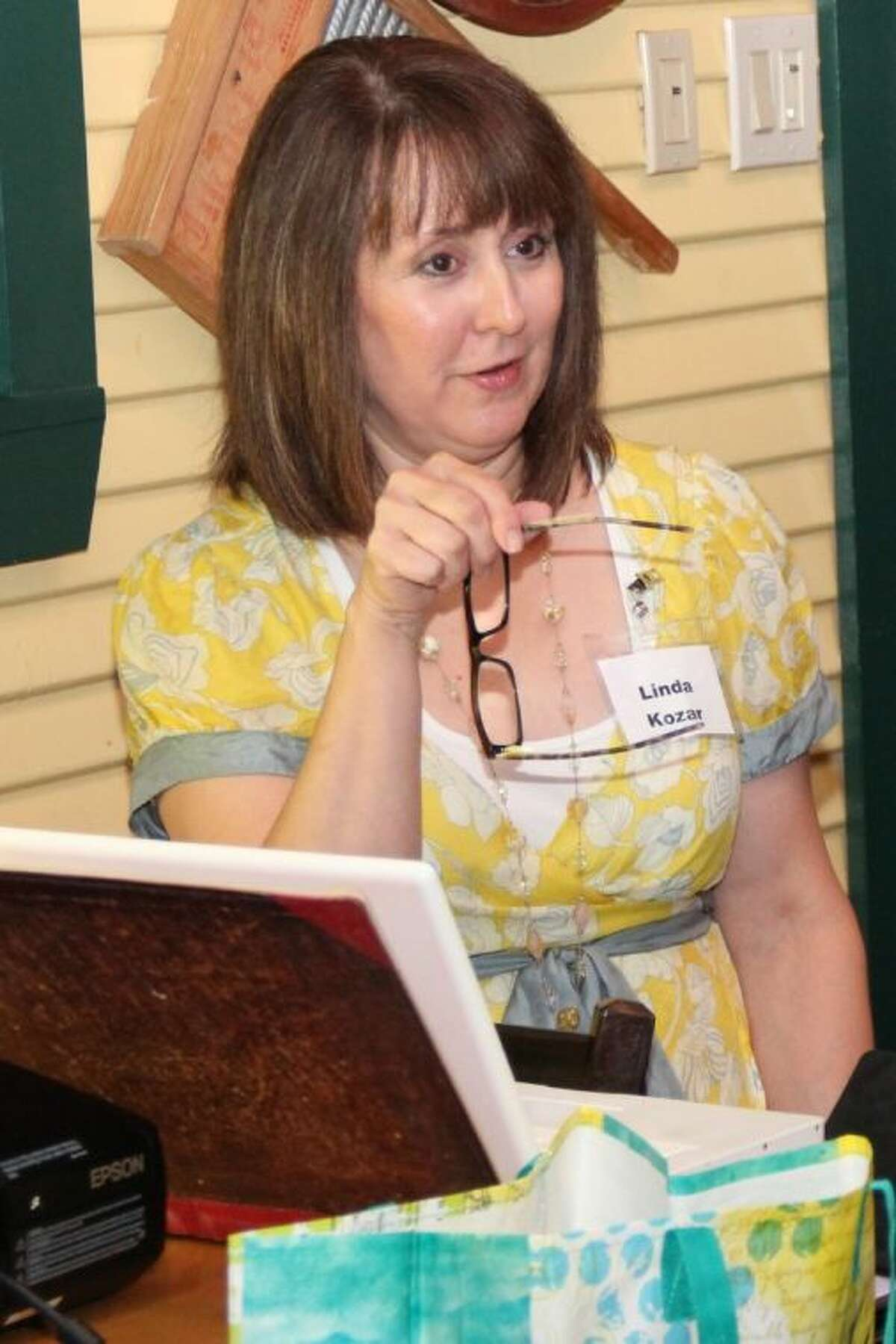 """Author Linda Kozar, of The Woodlands teaches other local writers """"50 Ways to Say Yellow"""" during the July meeting of Writers on The Storm, a local chapter of American Christian Fiction Writers."""