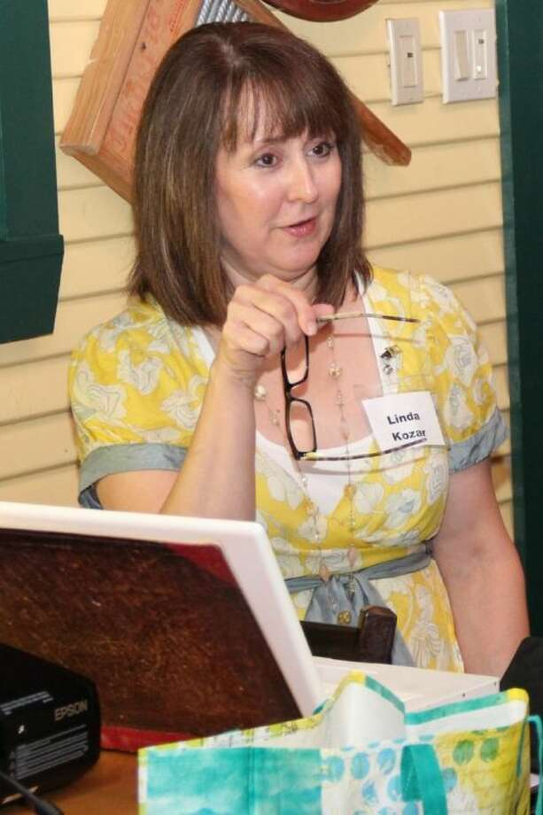 "Author Linda Kozar, of The Woodlands teaches other local writers ""50 Ways to Say Yellow"" during the July meeting of Writers on The Storm, a local chapter of American Christian Fiction Writers. Photo: Picasa"