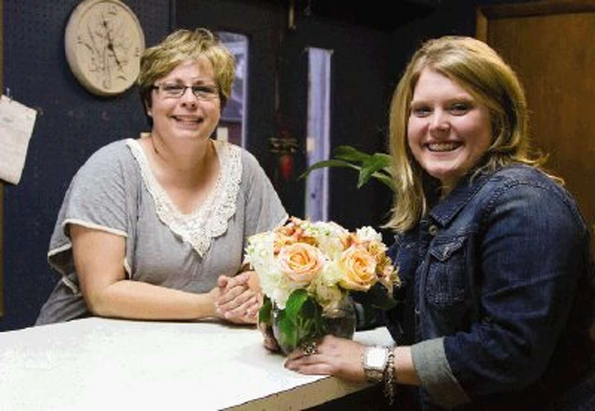 Kay and Jessica Carter work at their family business, Carter's Florist, on Tuesday afternoon in Conroe. The business has been family owned and operated for more than 40 years.