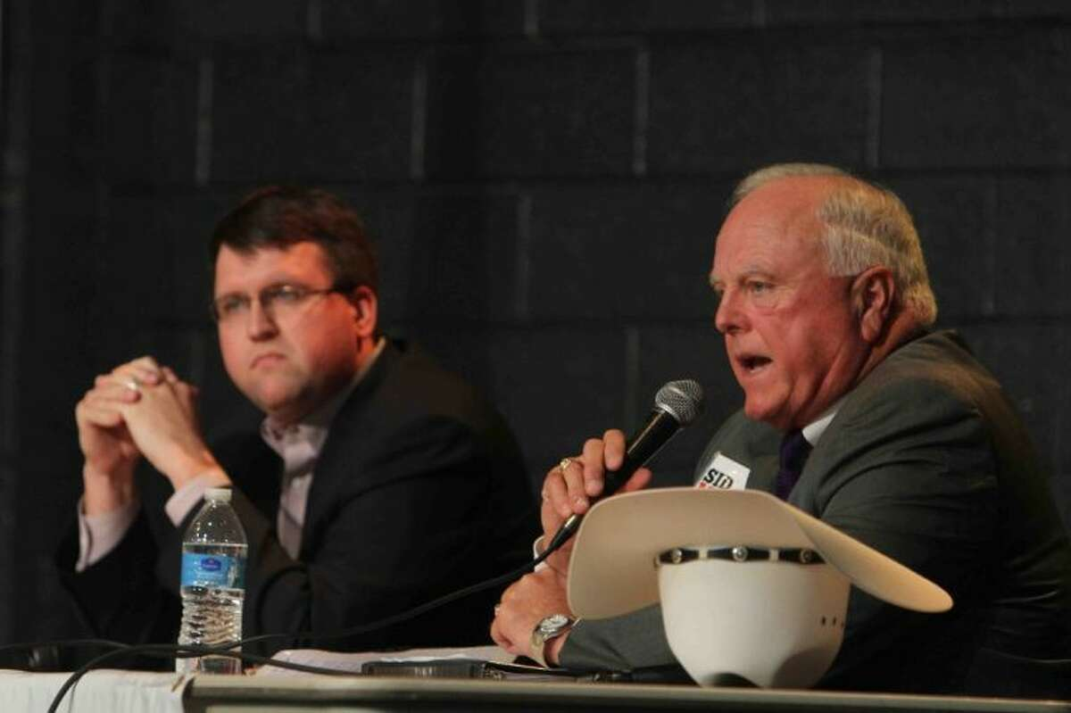 Texas agriculture commissioner candidate Sid Miller answers a question as fellow candidate Eric Opiela looks on during a statewide Republican Primary debate at First Baptist Church of Conroe Wednesday. Candidates for land commissioner, agriculture commissioner and lieutenant governor attended the debate. Go to HCNPics.com to view more photos from the debate.
