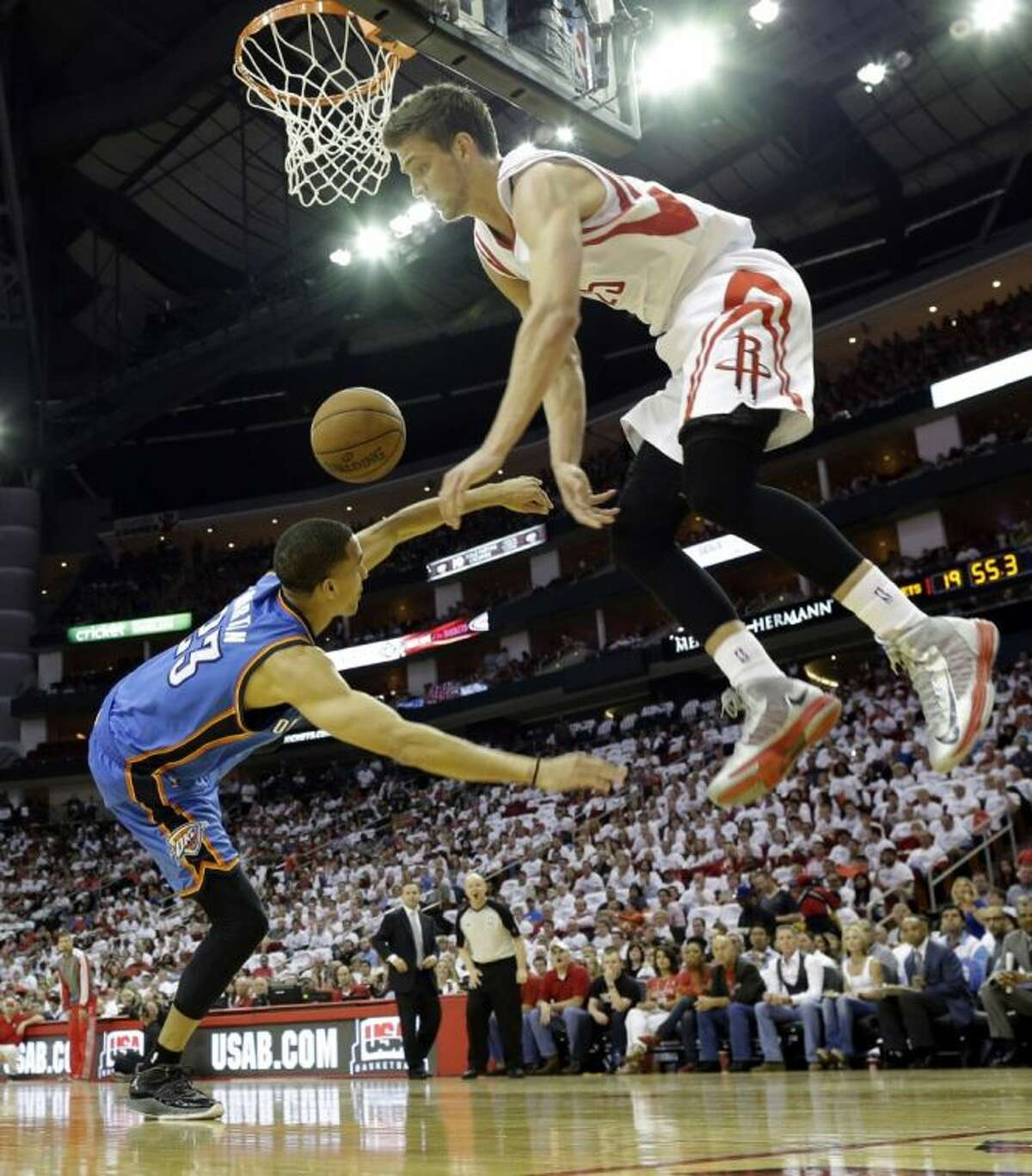 The Houston Rockets' Chandler Parsons fouls the Oklahoma City Thunder's Kevin Martin during the first quarter of Game 3 on Saturday in Houston.