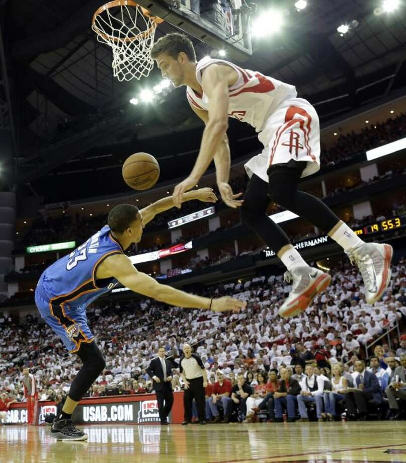 The Houston Rockets' Chandler Parsons fouls the Oklahoma City Thunder's Kevin Martin during the first quarter of Game 3 on Saturday in Houston. Photo: David J. Phillip
