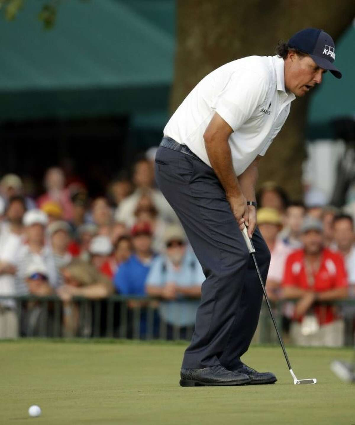 Phil Mickelson reacts after missing a putt on the 18th hole during the third round of the U.S. Open. Mickelson leads the tournament by one shot.