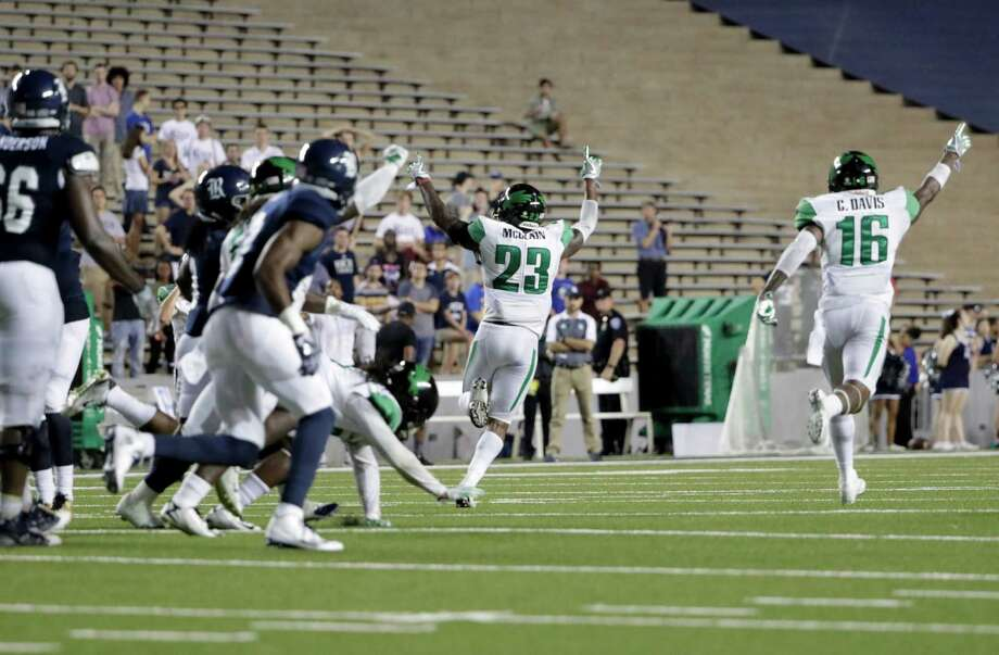 The North Texas Mean Green celebrate on the final play during the NCAA football game between the North Texas Mean Green and the Rice Owls at Rice Stadium in Houston, TX on Saturday, September 24, 2016.  The Mean Green defeated the Owls 42-35 in double overtime. Photo: Tim Warner, For The Chronicle / Houston Chronicle
