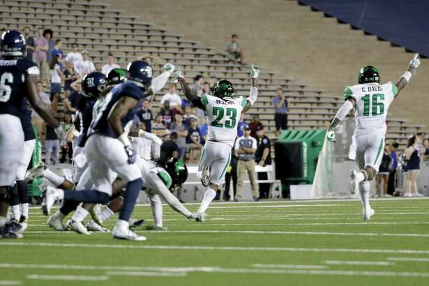 The North Texas Mean Green celebrate on the final play during the NCAA football game between the North Texas Mean Green and the Rice Owls at Rice Stadium in Houston, TX on Saturday, September 24, 2016.  The Mean Green defeated the Owls 42-35 in double overtime.