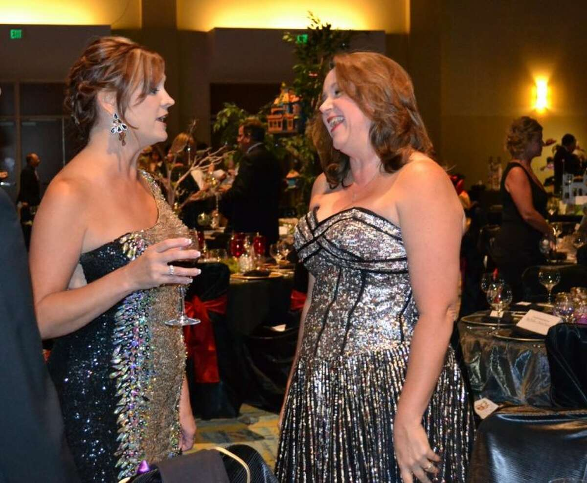 Chairman Amy Milstead, left, converses with Michelle Schafer, her executive assistant at Milstead Automotive, during Saturday night's 35th Annual Chairman's Ball at The Woodlands Waterway Marriott.