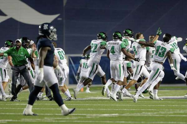 The North Texas Mean Green celebrates after winning the NCAA football game between the North Texas Mean Green and the Rice Owls at Rice Stadium in Houston, TX on Saturday, September 24, 2016.  The Mean Green defeated the Owls 42-35 in double overtime.