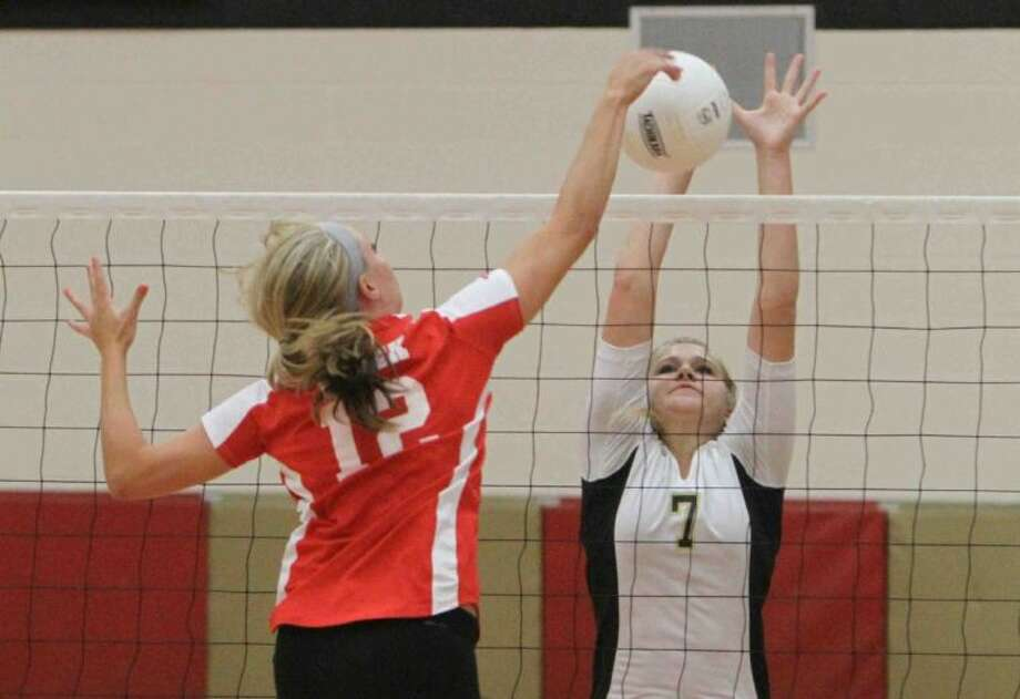 Conroe's Jane Shute blocks a shot by Caney Creek's Paige Selph during a match on Tuesday in Grangerland. To view or purchase this photo and others like it, visit HCNpics.com. Photo: Staff Photo By Jason Fochtman