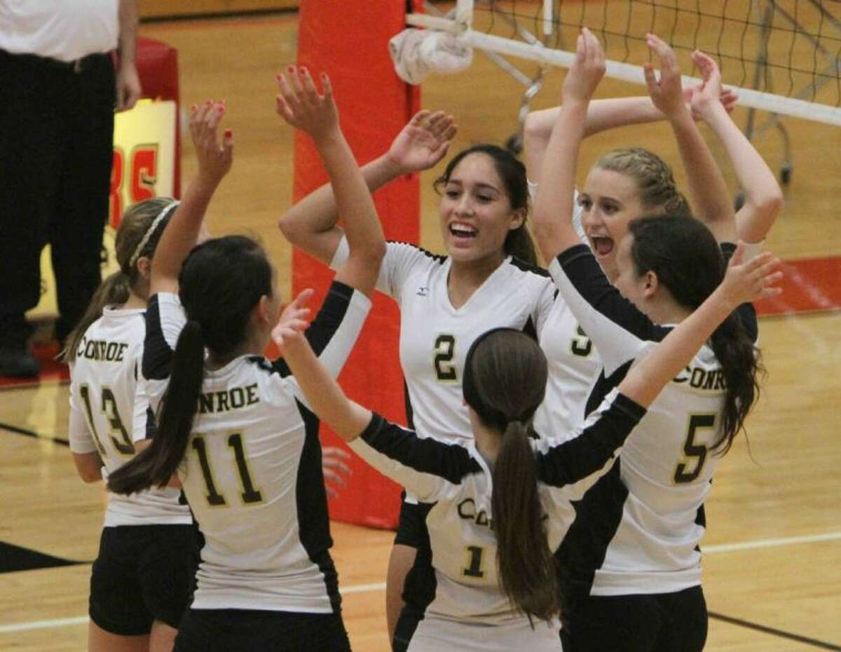 Conroe's Jules Vitela (2) celebrates with her teammates after a point during a match against Caney Creek on Tuesday in Grangerland. To view or purchase this photo and others like it, visit HCNpics.com.