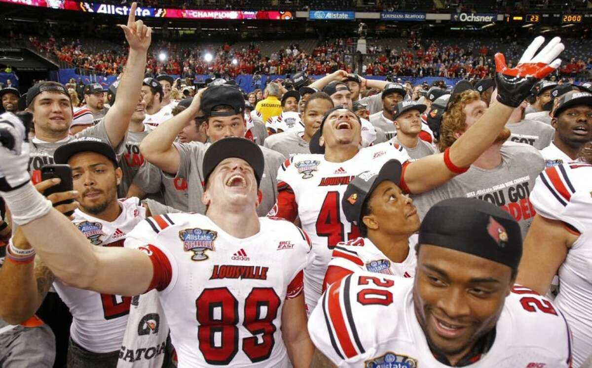 Louisville players celebrate after a 33-23 win over Florida in the Sugar Bowl in New Orleans.