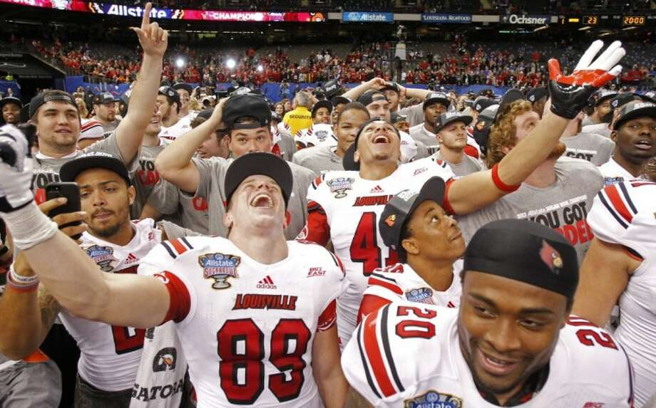 Louisville players celebrate after a 33-23 win over Florida in the Sugar Bowl in New Orleans. Photo: Bill Haber