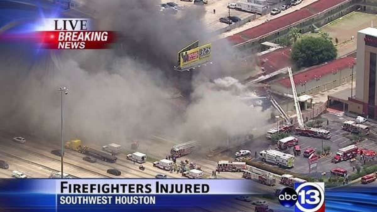 Firefighters are fighting a five-alarm fire at a Bhojan Restaurant at 6855 Southwest Freeway IB and an adjoining Southwest Inn Motel.