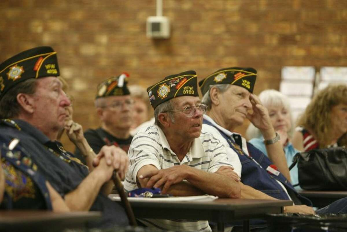 Veterans listen during a Memorial Day ceremony Monday at the Conroe VFW Post 4709 in Conroe.