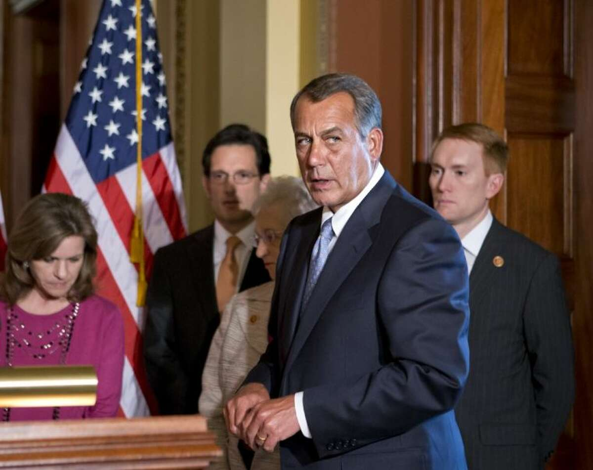 House Speaker John Boehner of Ohio, accompanied by fellow members of the House GOP leadership, responds to President Barack Obama's remarks to the nation's governors Monday about how to fend off the impending automatic budget cuts.