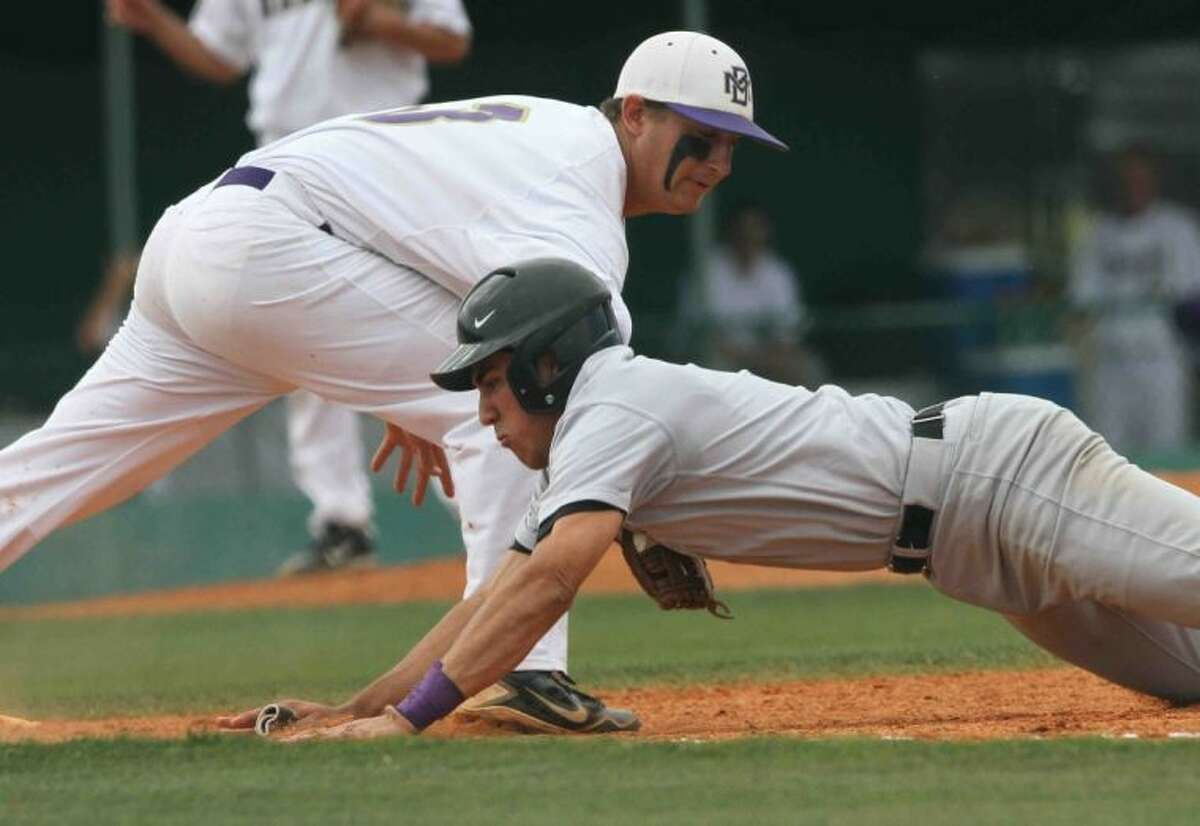 Montgomery first baseman Ty Boland completes the pickoff attempt on Kingwood Park's James Barry during a high school area baseball playoff game at Montgomery High School on Friday. Barry was out on the play. Kingwood Park defeated Montgomery 2-1 in Game 1 before the Bears won Game 2 9-1, thanks in part to Boland's three-run homer in the fifth inning. Go to HCNPics.com to view and purchase this photo, and others like it.
