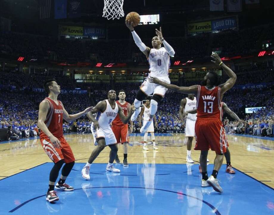 The Houston Rockets' defense is caught flat footed on Thunder guard Russell Westbrook's drive to the basket. The Thunder crushed the Rockets 102-91 in Game 1 of their best-of-seven NBA playoff series on Sunday night. Photo: Sue Ogrocki