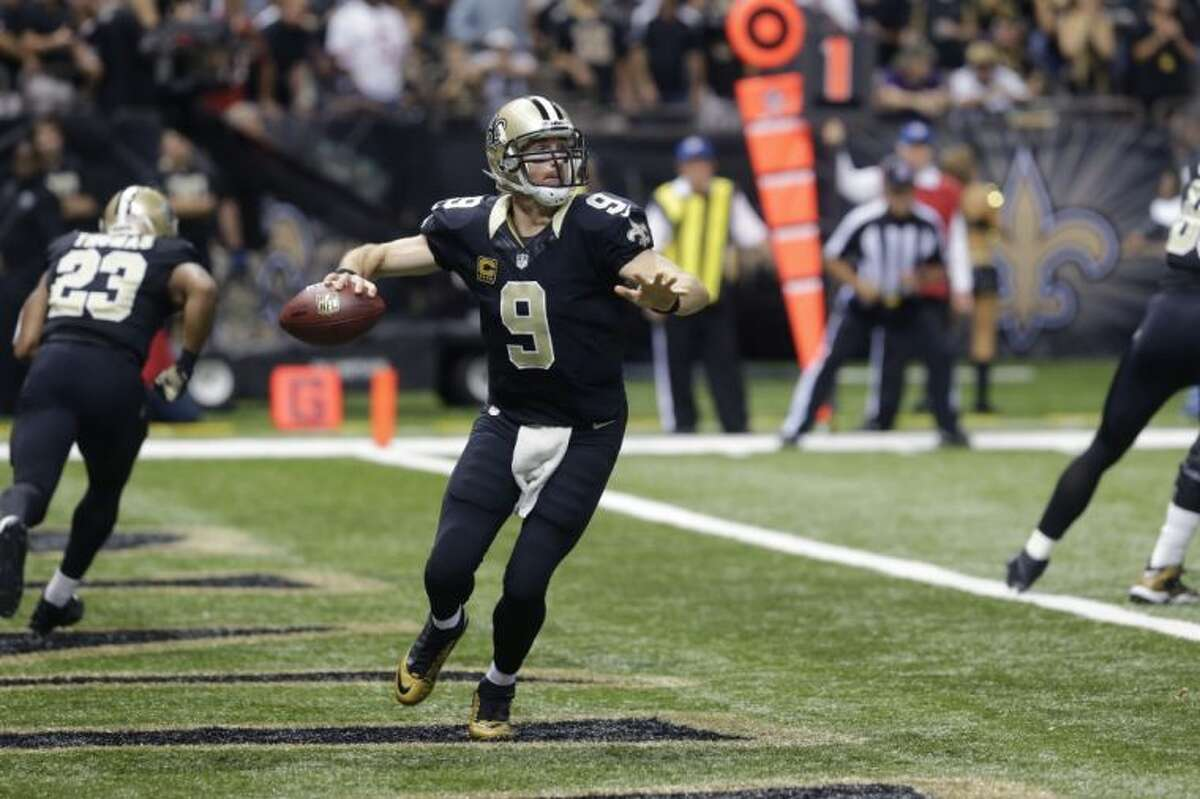 New Orleans Saints quarterback Drew Brees passes from the end zone in the first half against the San Francisco 49ers on Sunday in New Orleans.