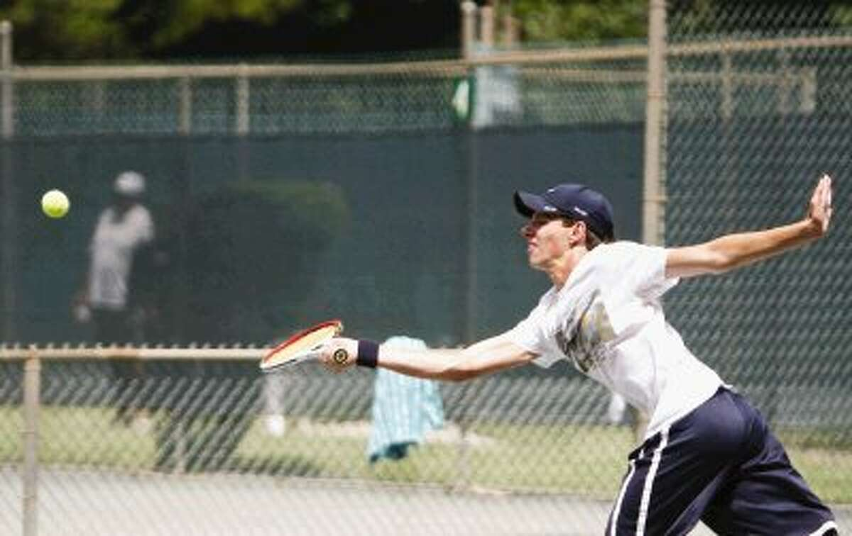Austin Walker of The Woodlands competes in the boys 18-under SuperChamps division of the 35th annual Woodlands Junior Clay Court Championships on Friday. To view or purchase this photo and others like it, visit HCNpics.com.