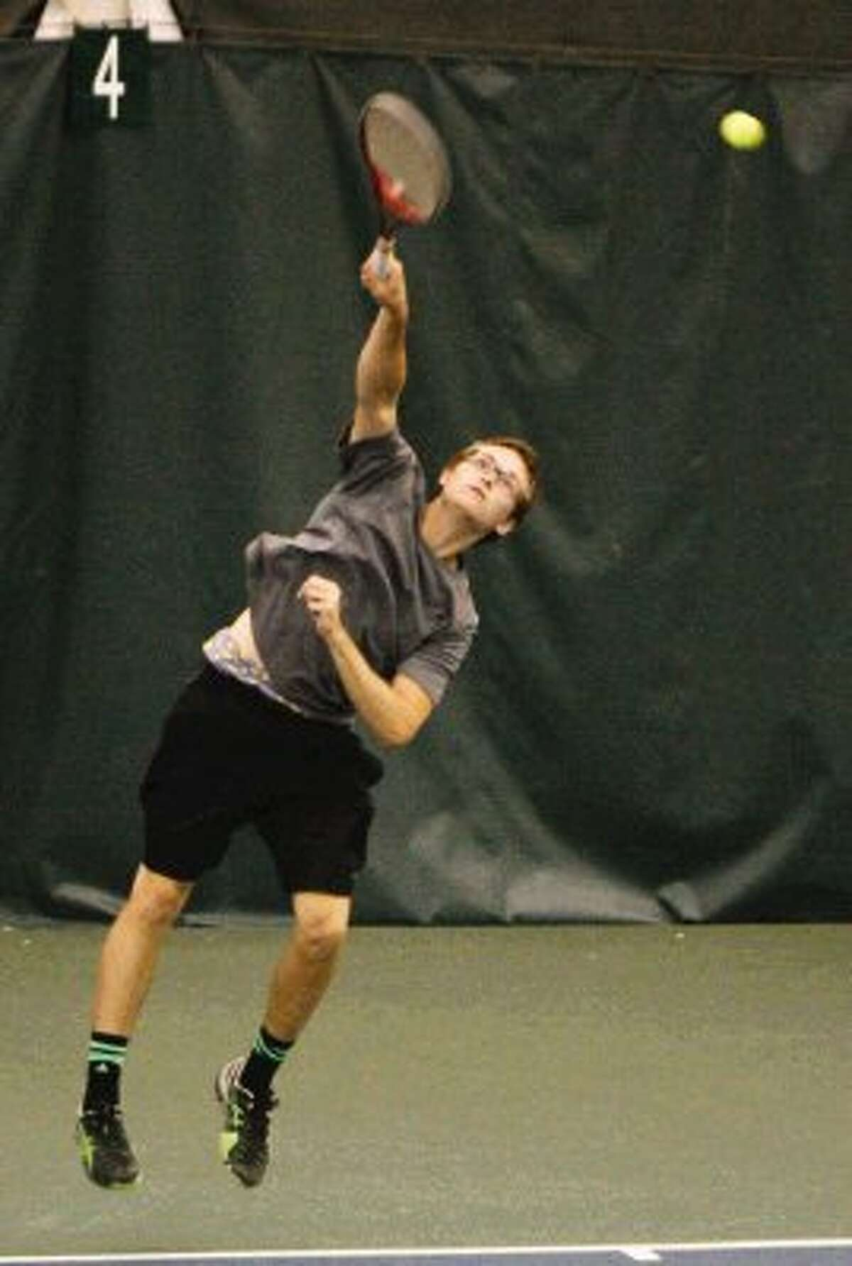 Kyle Bordovsky of The Woodlands competes in a singles match on Friday at the 35th annual Woodlands Junior Clay Court Championships.