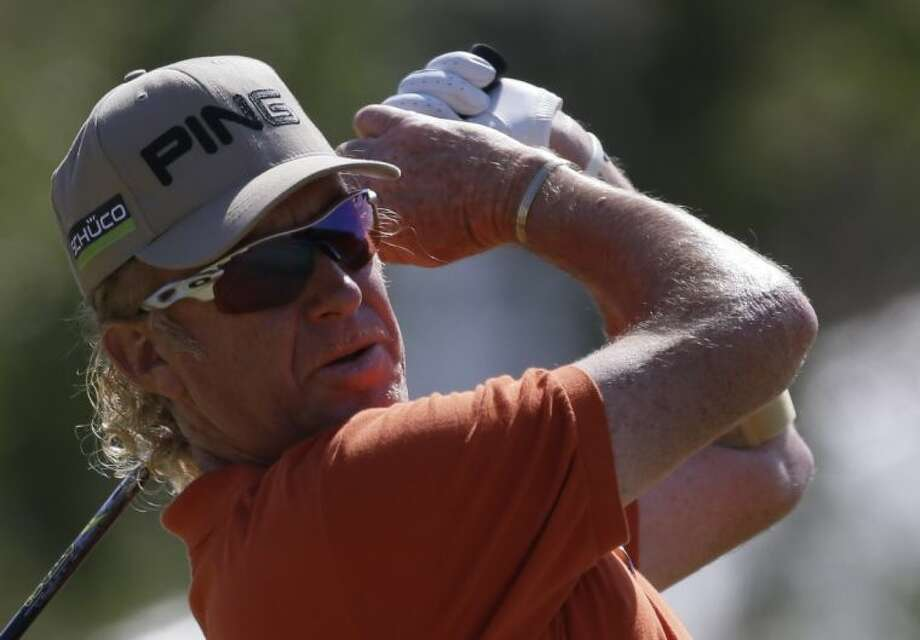 Miguel Angel Jimenez of Spain leads the British Open by one shot. Photo: Jon Super