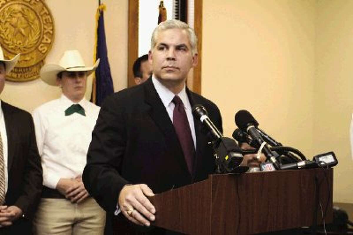 """Montgomery County District Attorney Brett Ligon answers questions from reporters during a press conference Monday in Conroe. Inmate Dorothy Canfield, 84, of Willis, is charged with Solicitation to Commit Capital Murder and Solicitation to Commit Aggravated Assault on a Public Servant in a plot to murder Montgomery County Assistant District Attorney Robert Freyer and put Ligon """"in the hospital for two to three weeks."""""""