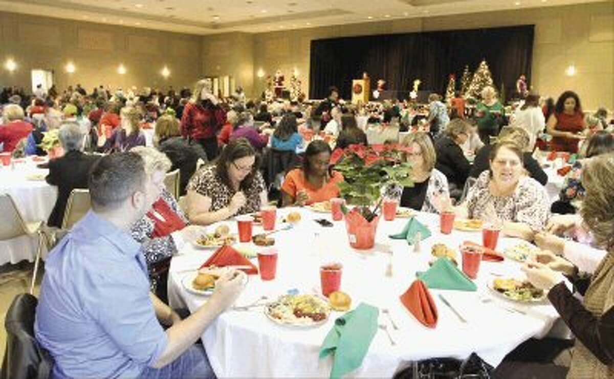 More than 650 Montgomery County employees celebrated the holidays during the county's annual Christmas party at the Lone Star Convention Center Tuesday.