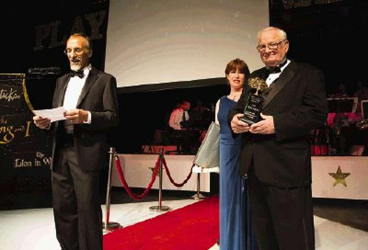 Carole Lamont looks on Roger Ormiston, left, congratulates Jim Walker on his recognition for the 2013 Lifetime Achievement Awards.
