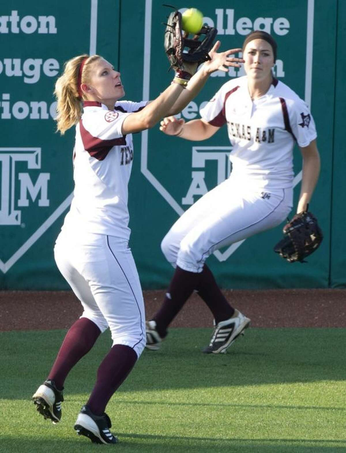 Texas A&M's Cali Lanphear` makes the grab for an out during the fifth inning in the Aggies' 8-0 victory over Baylor.
