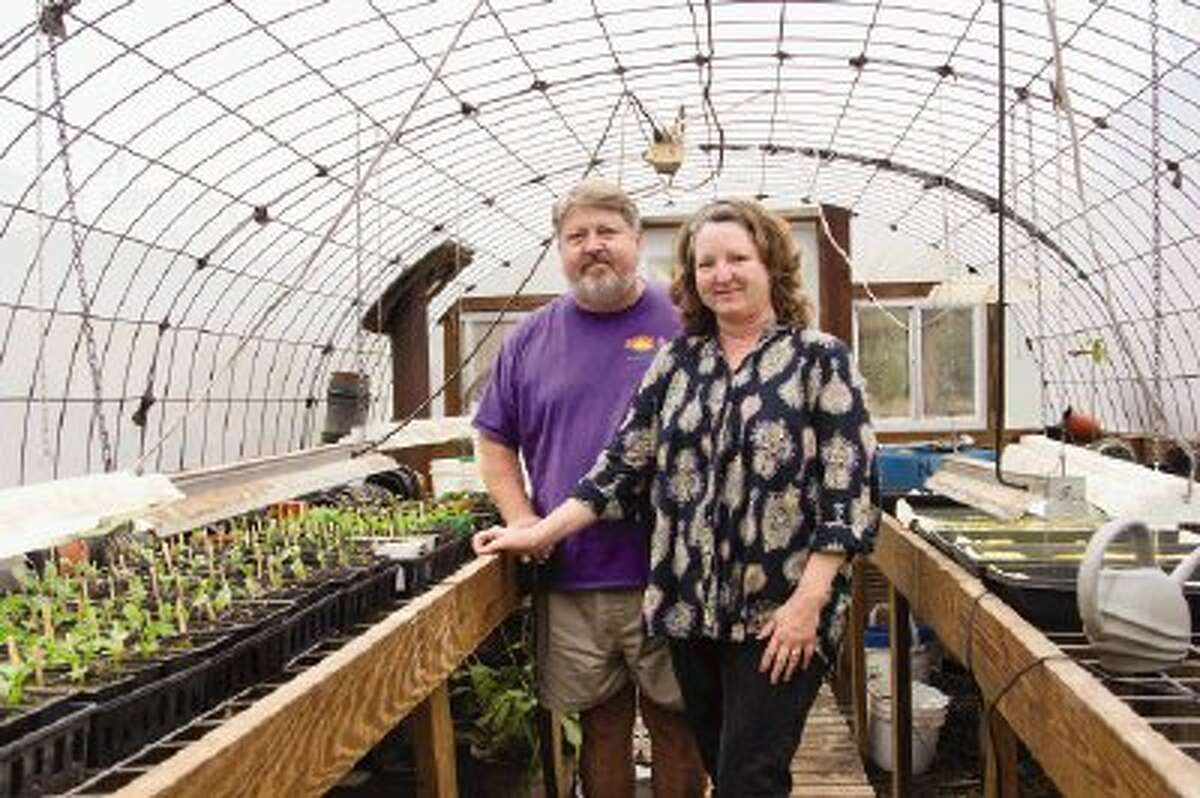 Jim and Lisa Jenkins stand in a greenhouse at Sunshine Farm in Montgomery.