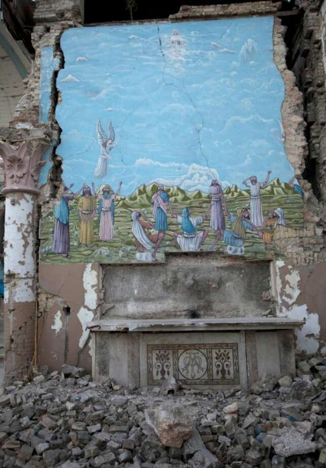 A mural featuring the Resurrection of Jesus Christ bears the signs of earthquake damage 3 years after a 7.0 earthquake struck, leveling a large part of the Santa Ana Catholic church, in Port-au-Prince, Haiti, Saturday. Photo: Dieu Nalio Chery / AP