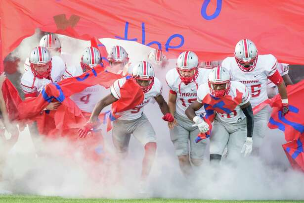 The Travis football team takes the field before a District 20-6A high school football game at Mercer Stadium on Saturday, September 24, 2016, in Sugarland.