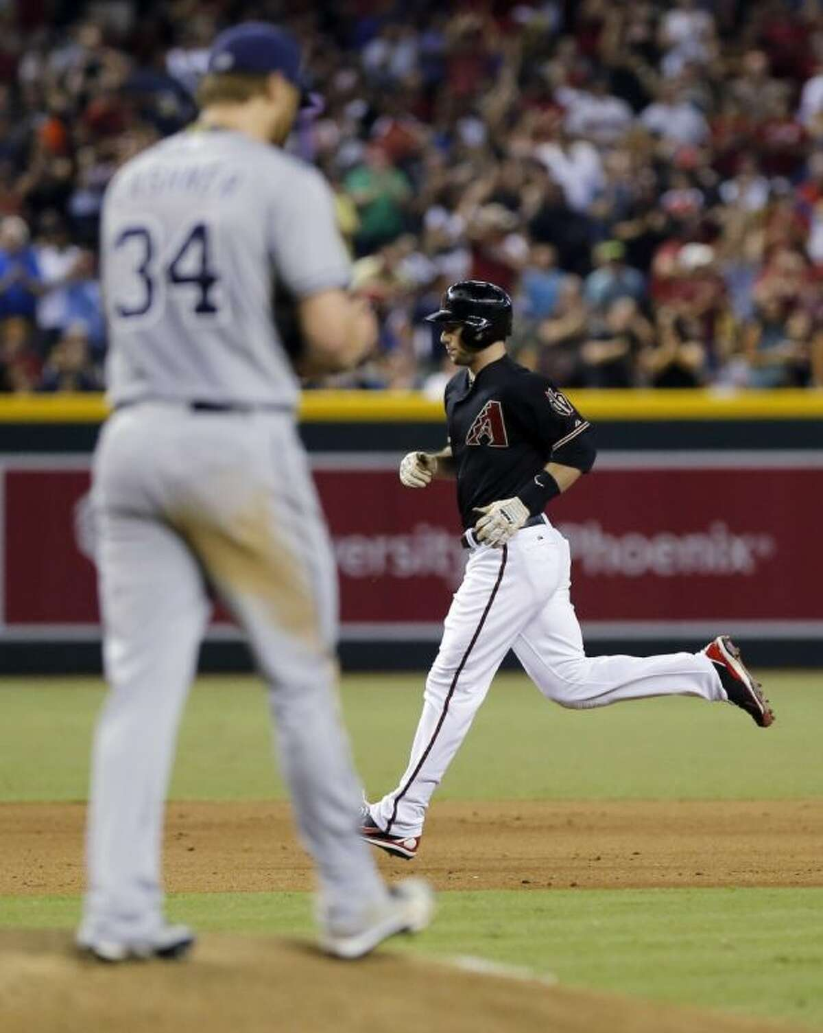 Arizona Diamondbacks first baseman Paul Goldschmidt rounds the bases after hitting a two-run home run off San Diego Padres pitcher Andrew Cashner during the fifth inning on Saturday in Phoenix. The graduate of The Woodlands High School leads the National League with 85 RBI.