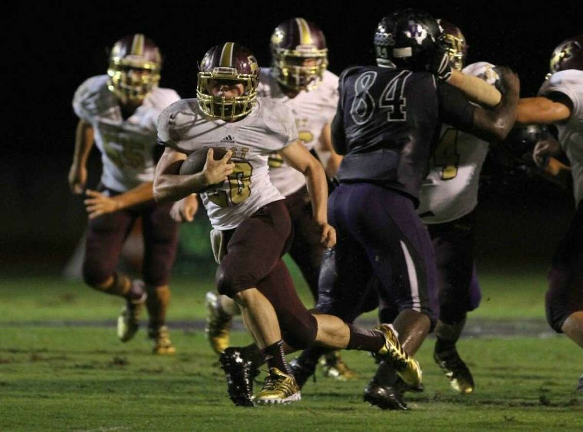 Magnolia West running back Chris Nicholson runs for a touchdown against Willis on Friday at Berton A. Yates Stadium. To view or purchase this photo and others like it, visit HCNpics.com.