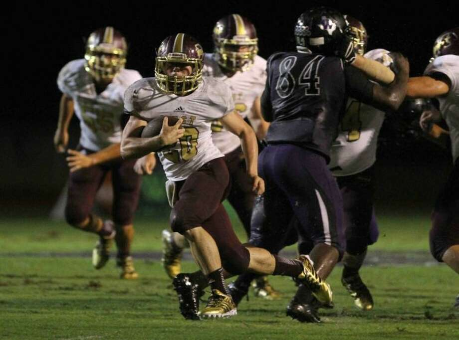 Magnolia West running back Chris Nicholson runs for a touchdown against Willis on Friday at Berton A. Yates Stadium. To view or purchase this photo and others like it, visit HCNpics.com. Photo: Staff Photo By Jason Fochtman