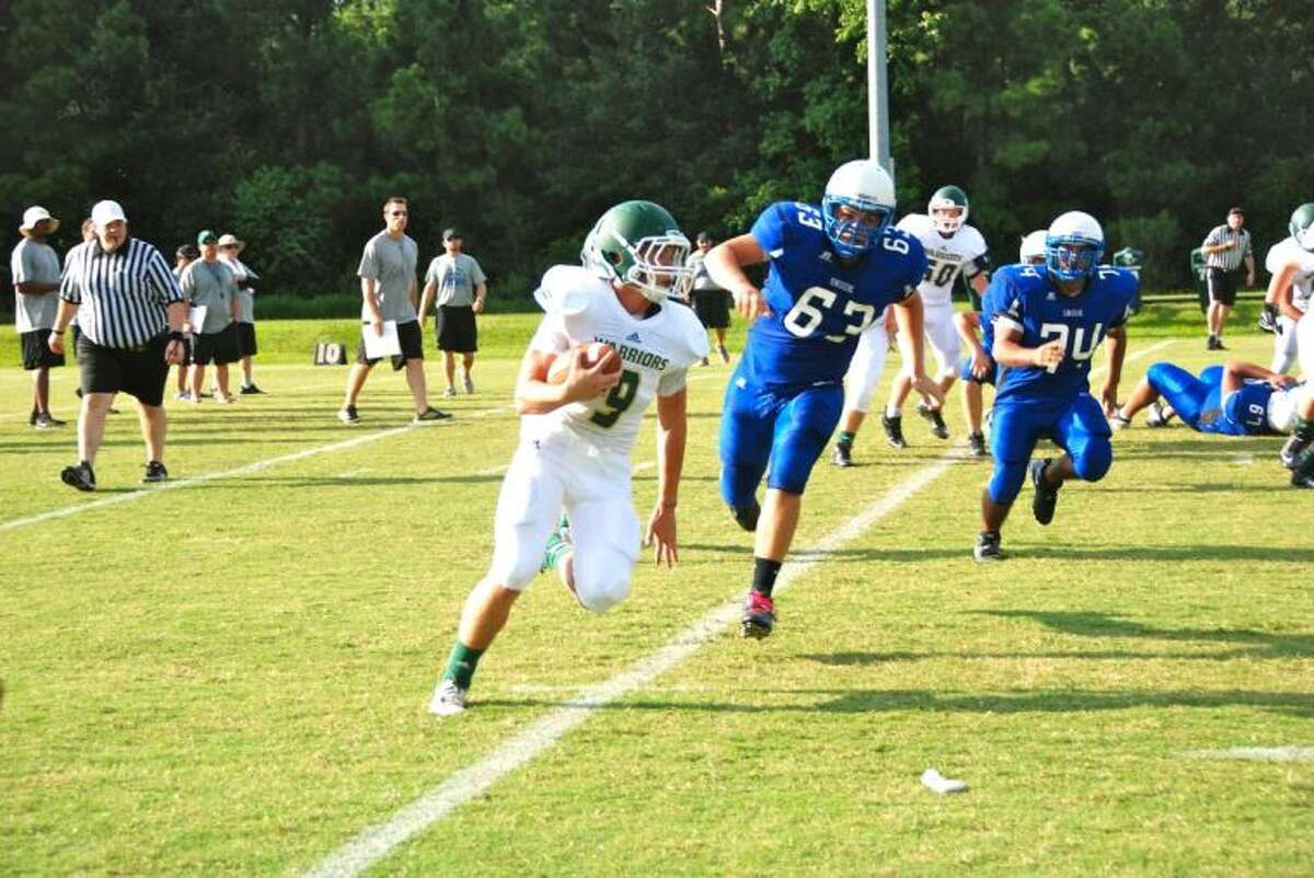 The Woodlands Christian's Luke Hudson breaks off a gain around right end in a scrimmage against Snook on Friday.
