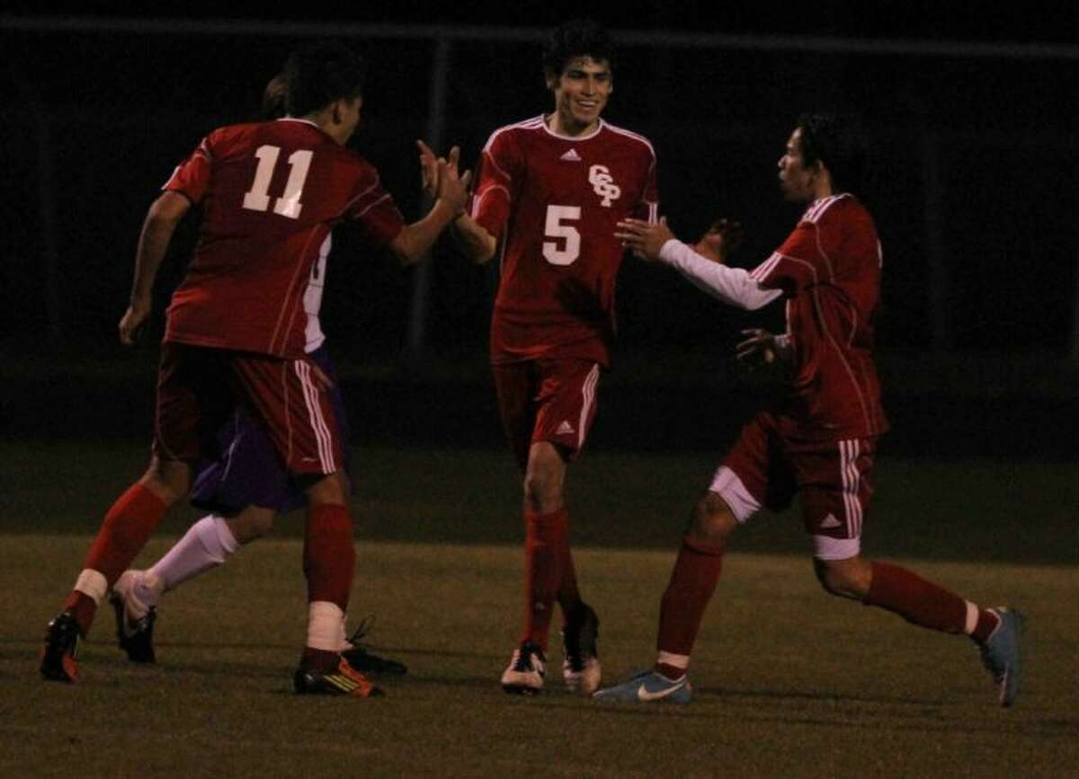 Caney Creek's Julio Gonzalez celebrates with teammates after scoring the eventual game-winning goal in the second half of Friday's match against Montgomery. To view or purchase this photo and others like it, visit HCNpics.com.