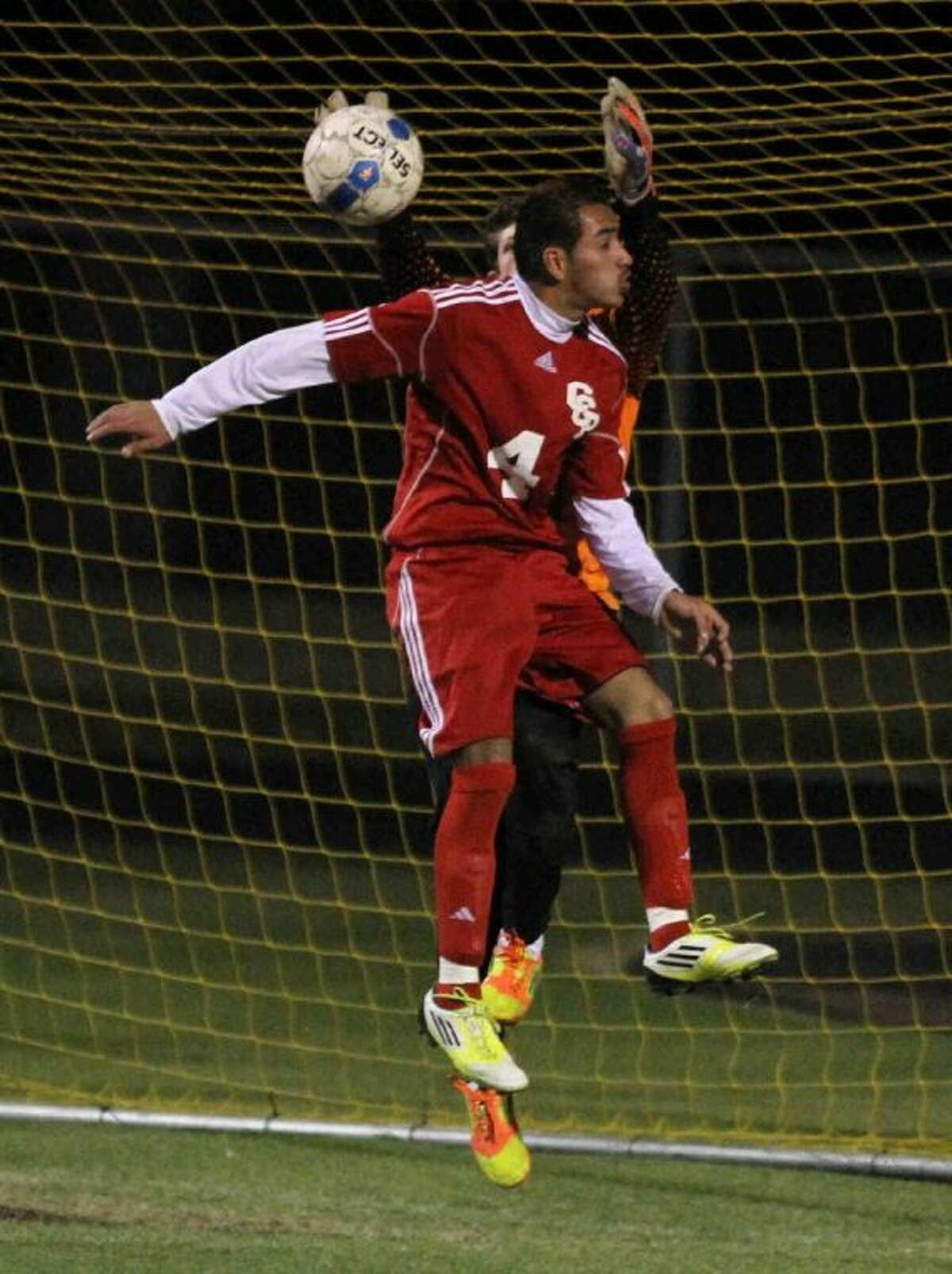 Caney Creek's Francisco Lopez tries to head the ball in for a score during Friday's match at Montgomery High School. To view or purchase this photo and others like it, visit HCNpics.com.