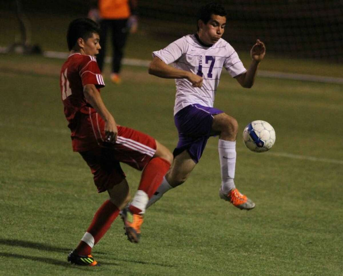 Montgomery's Fredy Perez gets to the ball first during Friday's match against Caney Creek. To view or purchase this photo and others like it, visit HCNpics.com.