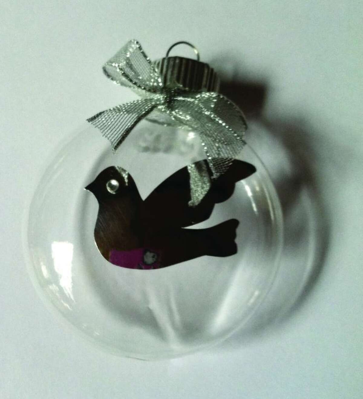 For 15 of the past 21 years, Jane Cashner has handmade each Tree of Remembrance Christmas ornament gifted for those who attend the Cashner Funeral Home's annual Tree of Remembrance Service. This year's theme, peace, is signified by the dove in flight.