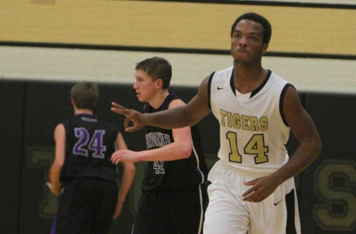 Conroe guard Stedman Bell celebrates after making a 3-pointer against Montgomery on Tuesday at Conroe High School. To view or purchase this photo and others like it, visit HCNpics.com.