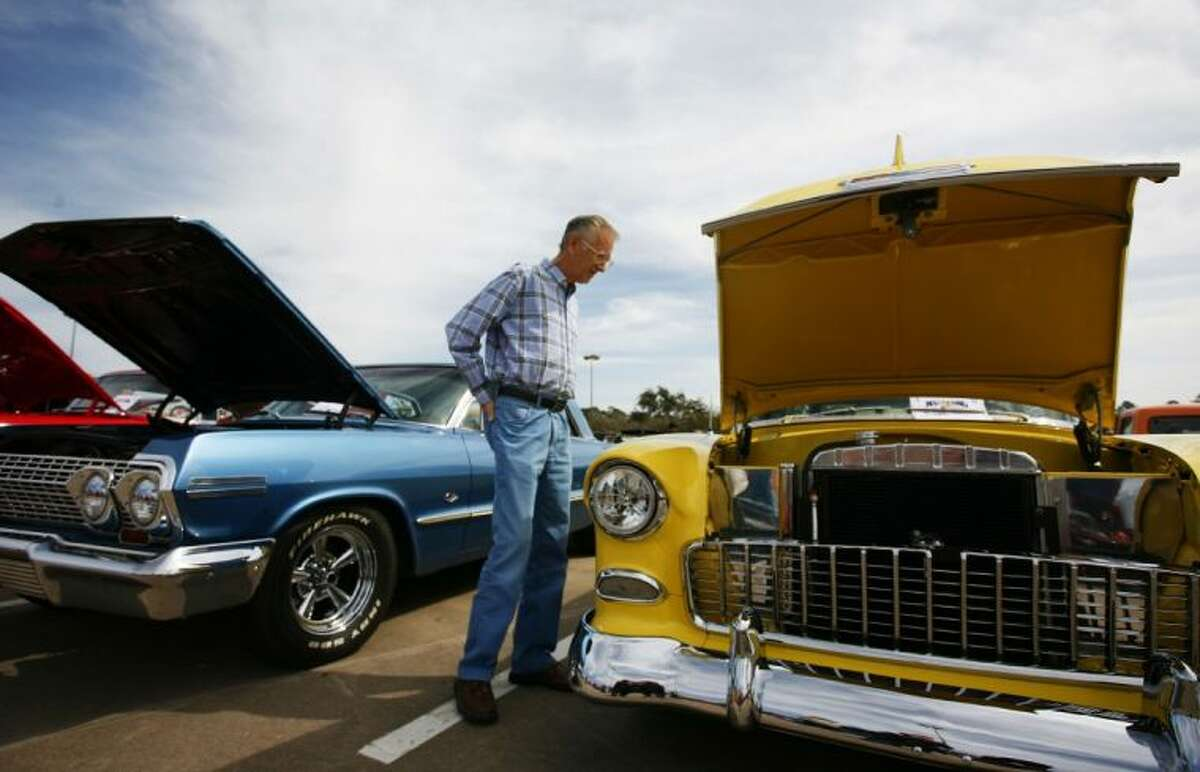 A man checks out some classic cars on display during the Cruise in Against Hunger Food Drive/Car Show on Saturday at The Outlets at Conroe. The event was hosted by the Montgomery County Mustang Car & Truck Club. To view or order this photo and others like it, visit: HCNPics.com