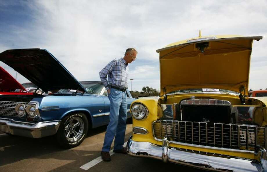 A man checks out some classic cars on display during the Cruise in Against Hunger Food Drive/Car Show on Saturday at The Outlets at Conroe. The event was hosted by the Montgomery County Mustang Car & Truck Club. To view or order this photo and others like it, visit: HCNPics.com Photo: Staff Photo By Eric Swist